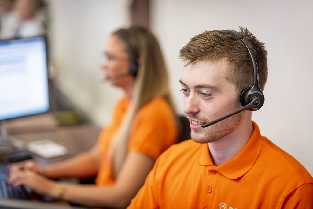 Amp team member speaking through headset in office