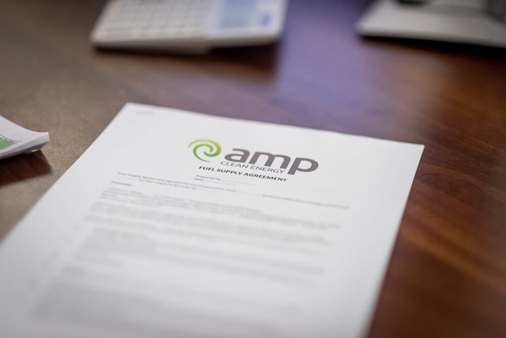 AMP Clean Energy Fuel Supply Agreement document on desk