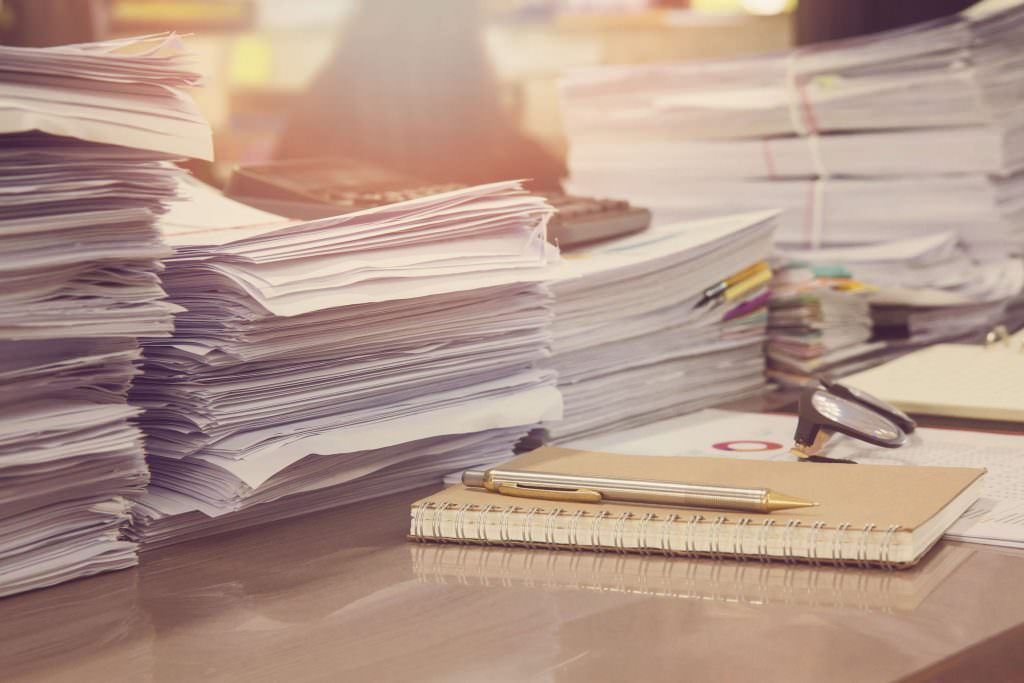Piles of paperwork on a desk